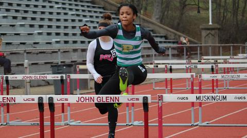 Jahniah McAllister placed in three events and won the 100 hurdles. Photo by Robert Berger.