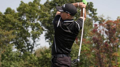 Gage Basiletti with a tee shot in Saturday's first round. Photo by Robert Berger.