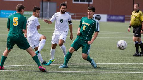 Rejep Mukhammedov (left) and Ricardo Dip (6) provided two of the eight assists for the Pioneers. Photo by Deanna Nemec