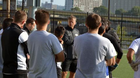 Pioneers head coach Jeroen Walstra talks to the team during preseason training at Highmark Stadium