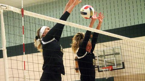 Ashley Taylor (left) and Savannah Dishman go up for a block in a match Sept. 5. Photo by Sam Robinson.